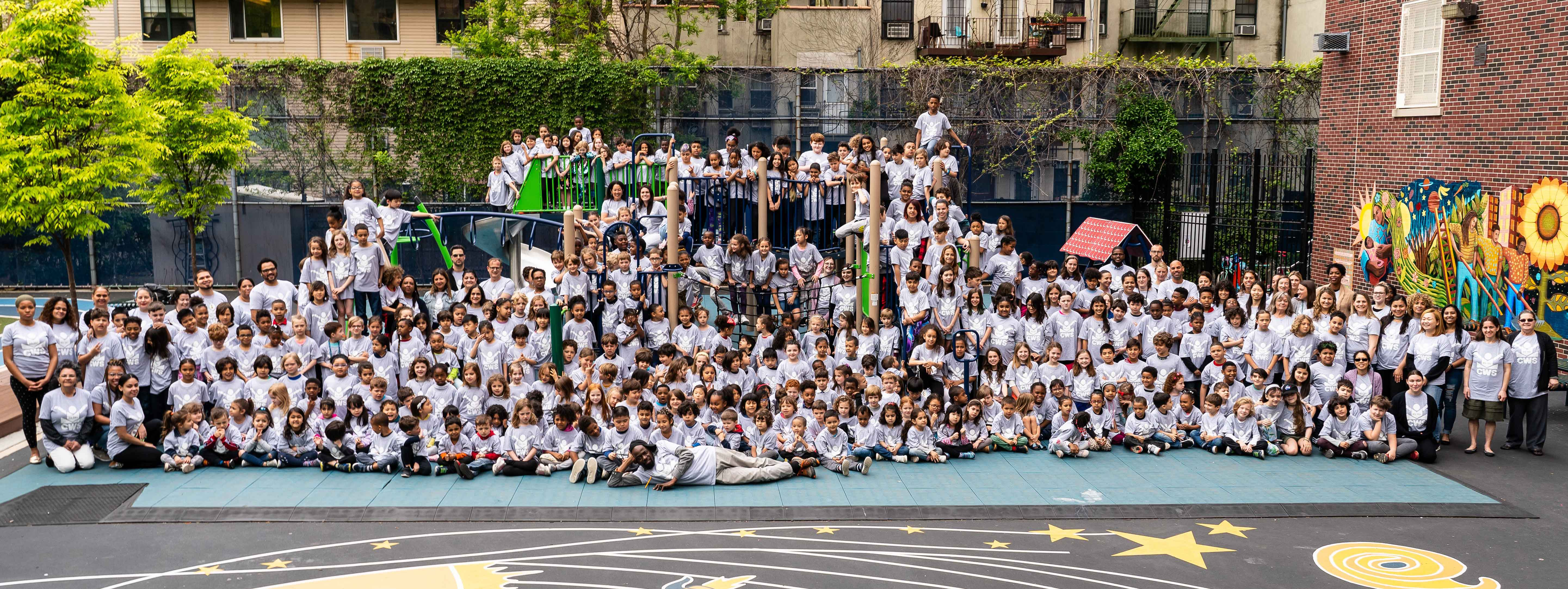 students, teachers, and staff of CWS on the playground in 2019