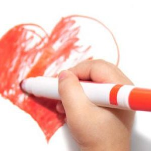 hand holding red marker coloring in heart